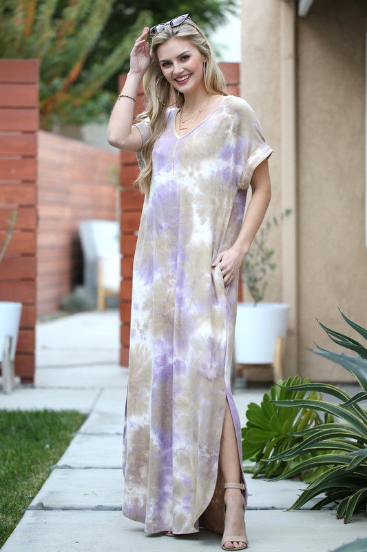 women wearing V-neck tie-die maxi dress with pocket and side split details