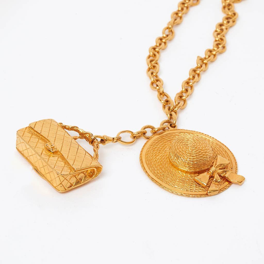 Lost & found:  Vintage Chanel boater hat and classic bag charm necklace