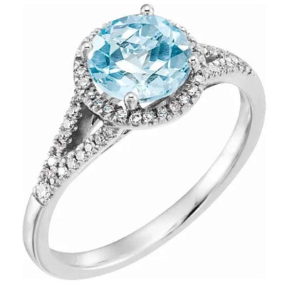 Sky blue topaz ring with halo diamond setting. Women's engagement ring. 14k white gold halo style engagement ring.