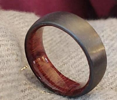Black zirconium ring with koa wood inlay