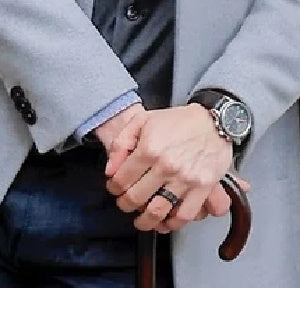 Man Wearing Black Wedding Ring