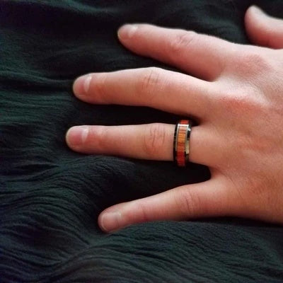 Man wearing black ceramic wedding ring