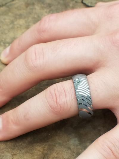 Man Wearing Damascus Steel Wedding Ring