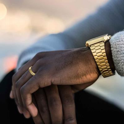 Man Wearing Gold Wedding Band with Scale Pattern