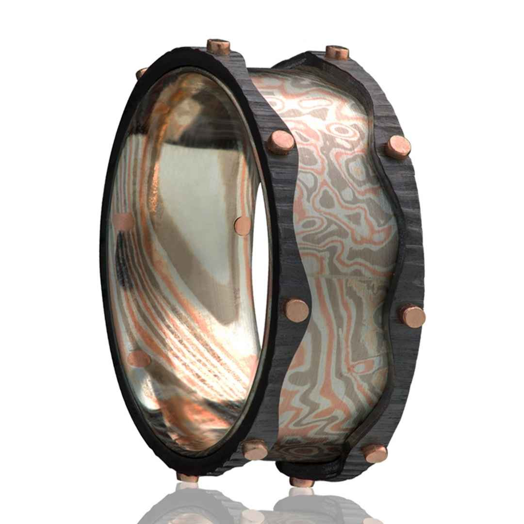 Men's mokume gane wedding ring with zirconium and rose gold