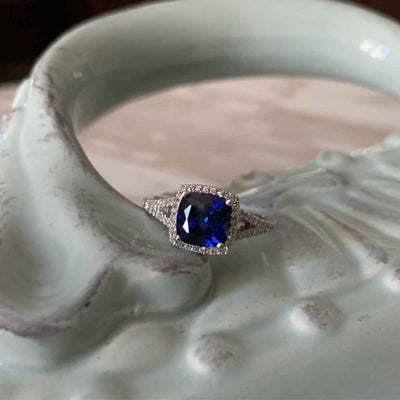 Women's blue sapphire halo engagement ring