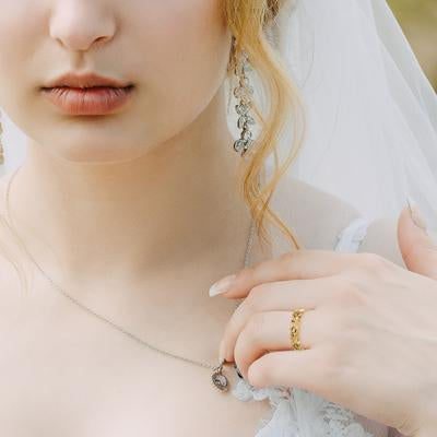 Gold Wedding Ring on Bride's Finger