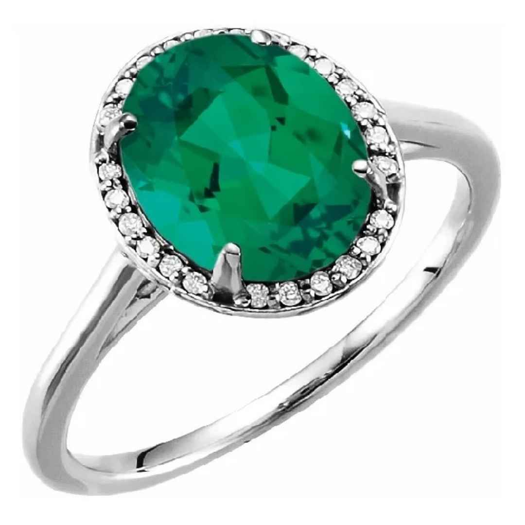 Women's 14K white gold emerald engagement ring with 10 x 8 mm stone