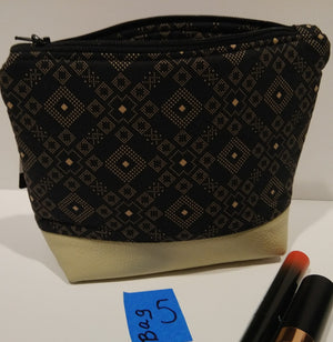 5-  Cosmetic Bag -black geo with tan leather bottom