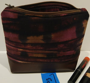 7-  Cosmetic Bag -purple, magenta, dark stripes with brown leather bottom