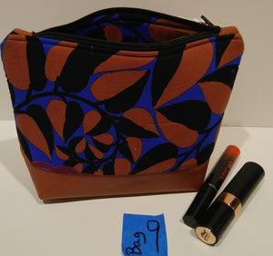 9-  Cosmetic Bag -blue, rust, black print with rust leather bottom