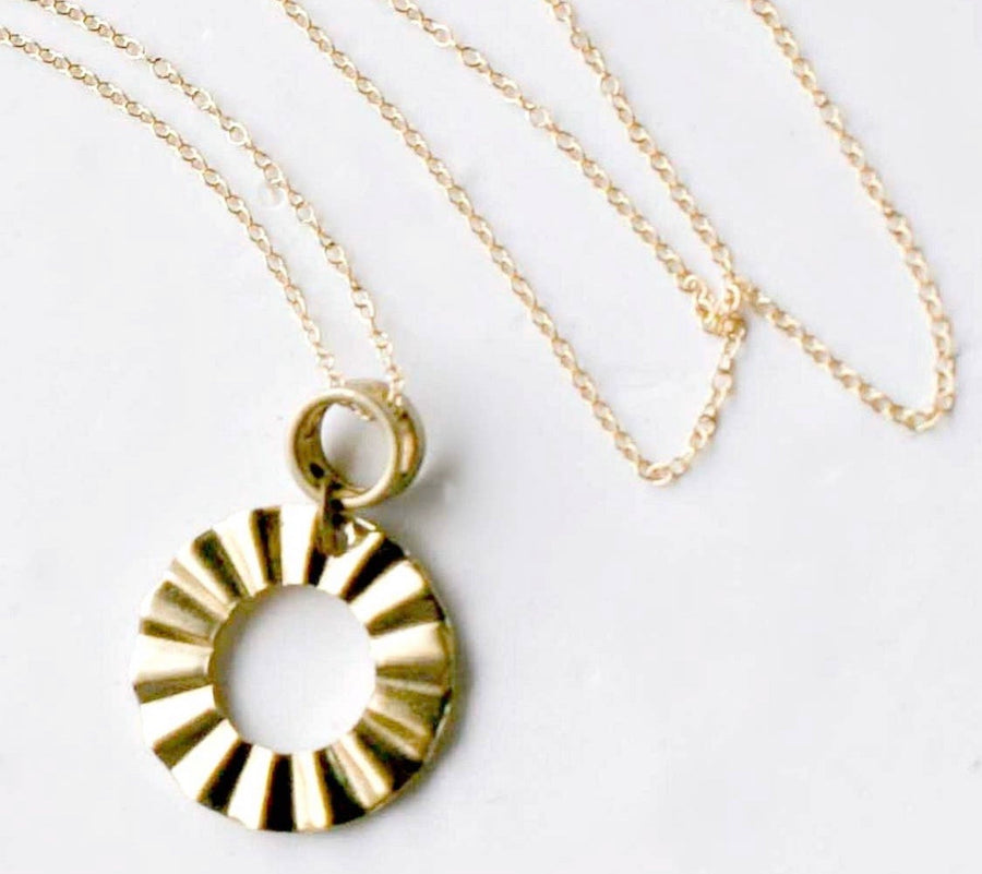 Wheel and Ruffle Pendant Necklace