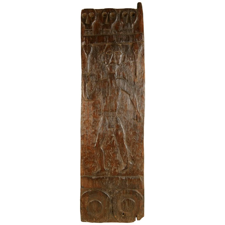 African Wooden Granary Door with Carved Motifs & Sculls