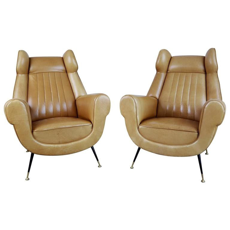 Rare Italian Ocher Leather Wingback Chairs with Brass Feet, Pair, circa 1960