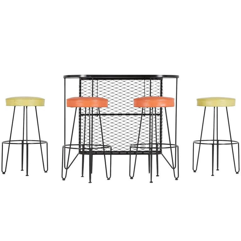 *SOLD* Frederick Weinberg, Restored Five-Piece Wrought Iron Bar and Stools, 1950s