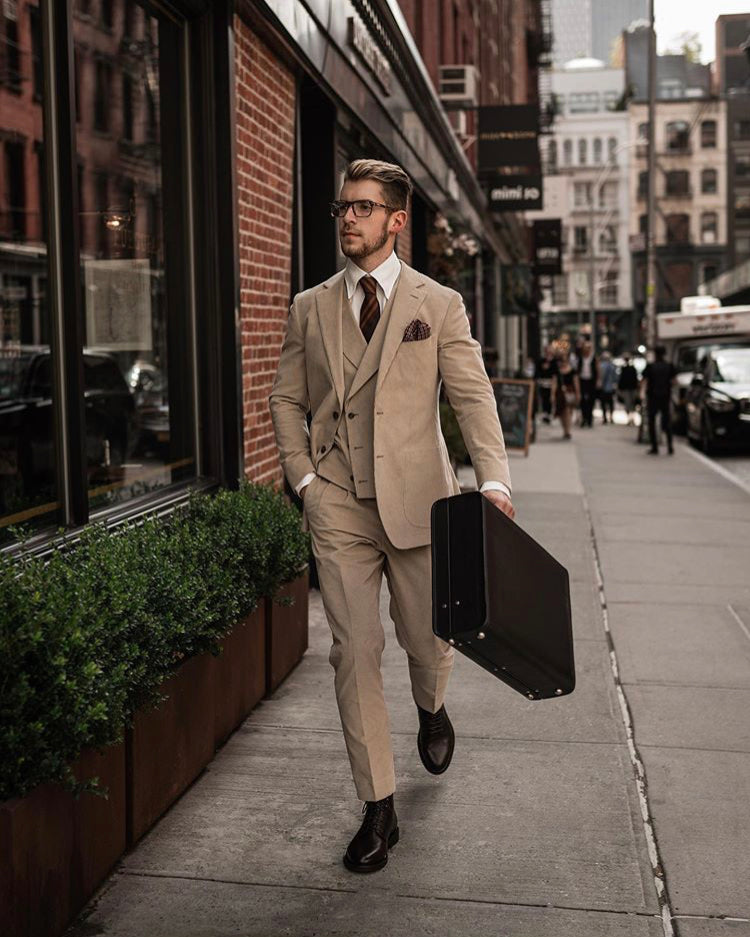 Suited man takes leather briefcase to New York City