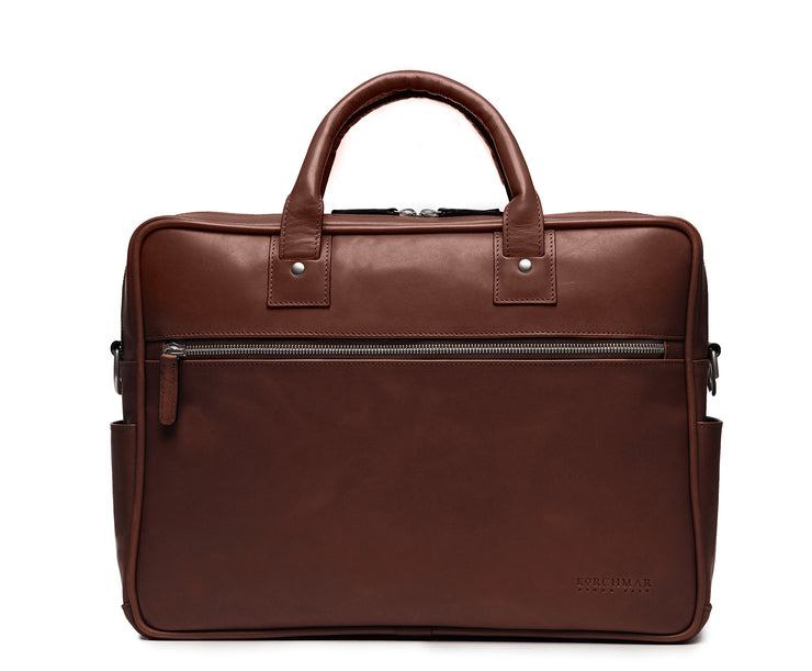 "Brown 15"" Leather Laptop Briefcase Meticulously designed with full-grain leather, the Redford leather briefcase is a seamless blend of modern functionality and classic style. With two zippered compartments, multiple organizational pockets and a dedicated laptop compartment, the Redford is designed to protect your everyday essentials."