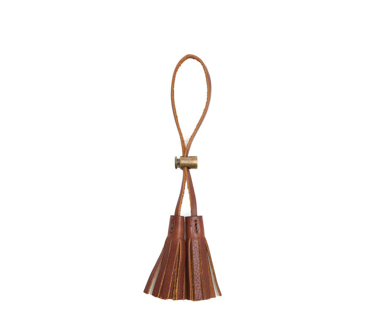 Chocolate Leather tassel keeper Add texture to your décor and get creative with the Cooper leather tassel keepers. Perfect for use as napkin holders, on curtains or doorknobs, as carry-on bag identifiers, and so much more. The Cooper leather tassel keepers are handcrafted with full-grain American leather.