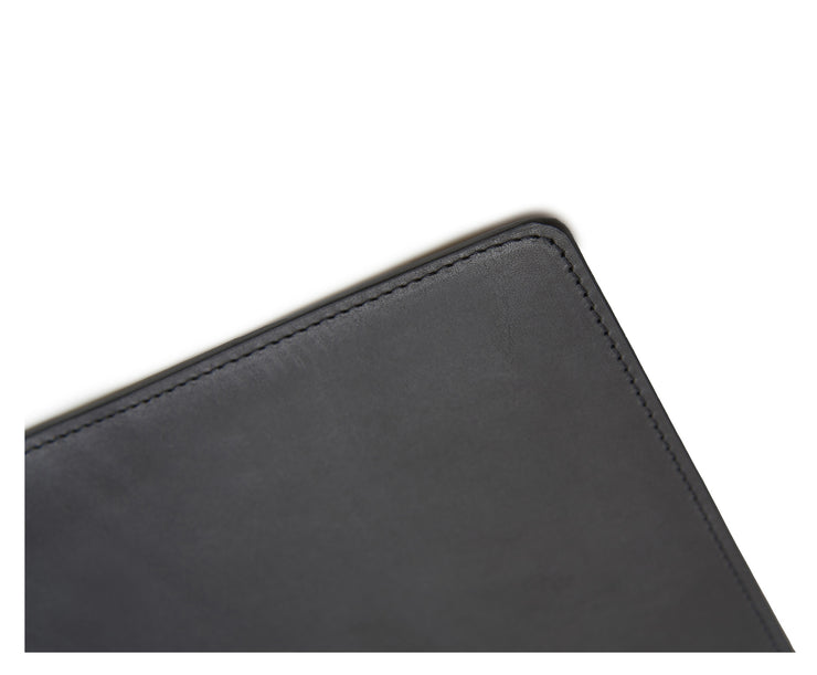 "Black Full-grain American leather Backed with non-skid durable rubber mat Each desk pad's selection is one-of-a-kind and slightly unique given the natural characteristics of the leather Handcrafted with care in our own factory Dimensions: 24"" W x 17.5"" H"