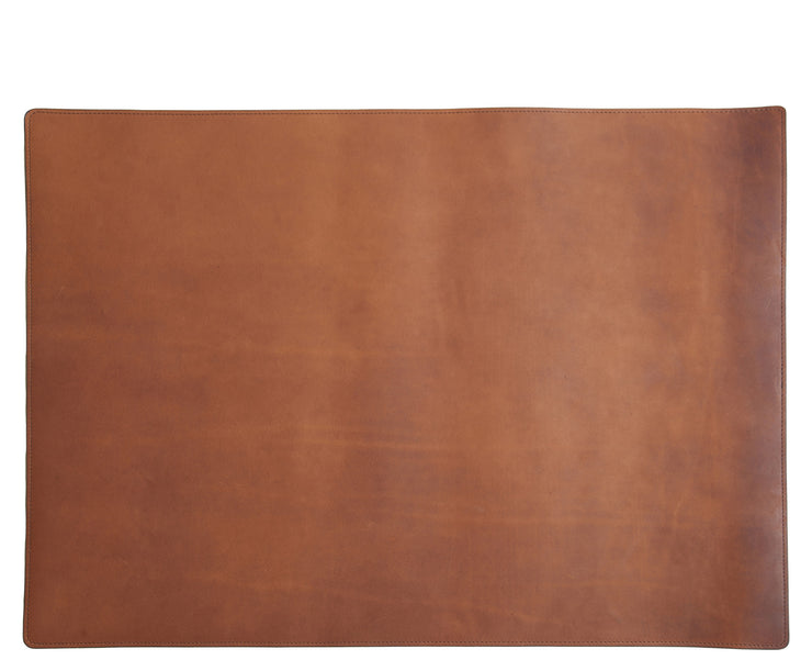 Espresso Leather desk pad Handcrafted with American full-grain leather, the Carter leather desk pad adds a sophisticated touch to your work-from-home setup while protecting your desk's surface from scratches.