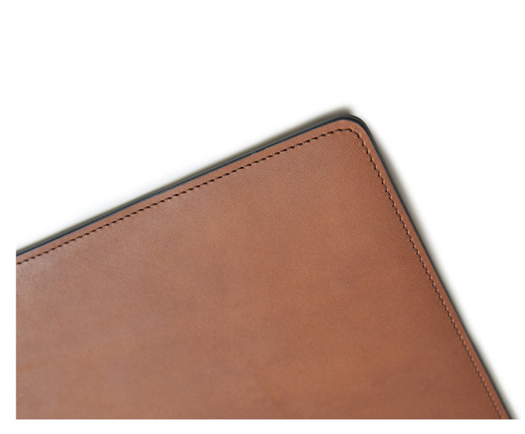 "Espresso Full-grain American leather Backed with non-skid durable rubber mat Each desk pad's selection is one-of-a-kind and slightly unique given the natural characteristics of the leather Handcrafted with care in our own factory Dimensions: 24"" W x 17.5"" H"