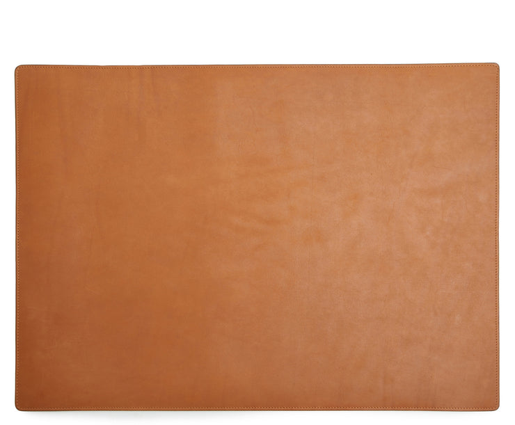 Tan Leather desk pad Handcrafted with American full-grain leather, the Carter leather desk pad adds a sophisticated touch to your work-from-home setup while protecting your desk's surface from scratches.