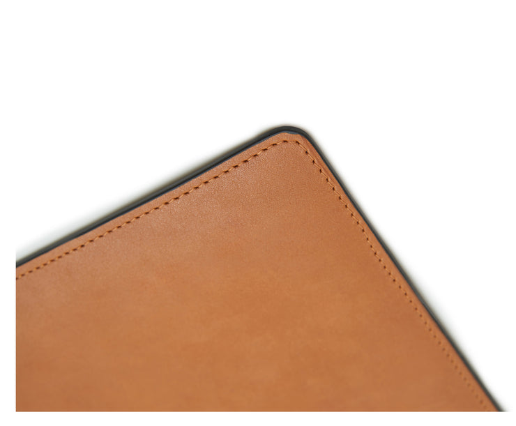 "Tan Full-grain American leather Backed with non-skid durable rubber mat Each desk pad's selection is one-of-a-kind and slightly unique given the natural characteristics of the leather Handcrafted with care in our own factory Dimensions: 24"" W x 17.5"" H"