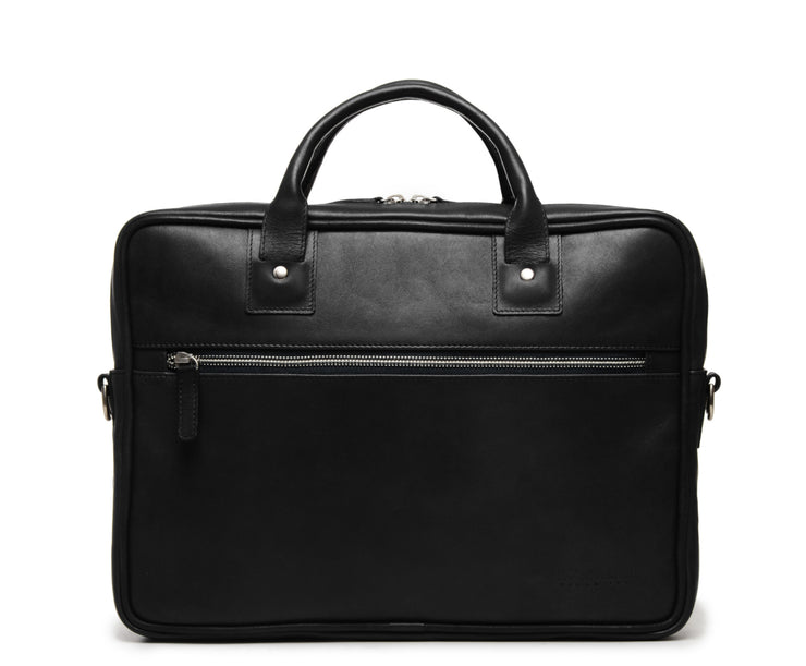 "Black Slim Leather Briefcase The Edwin leather briefcase features a removable, adjustable shoulder strap and built-in laptop sleeve. It is designed with a secure top zipper, and can safely accommodate most 13"" laptops."