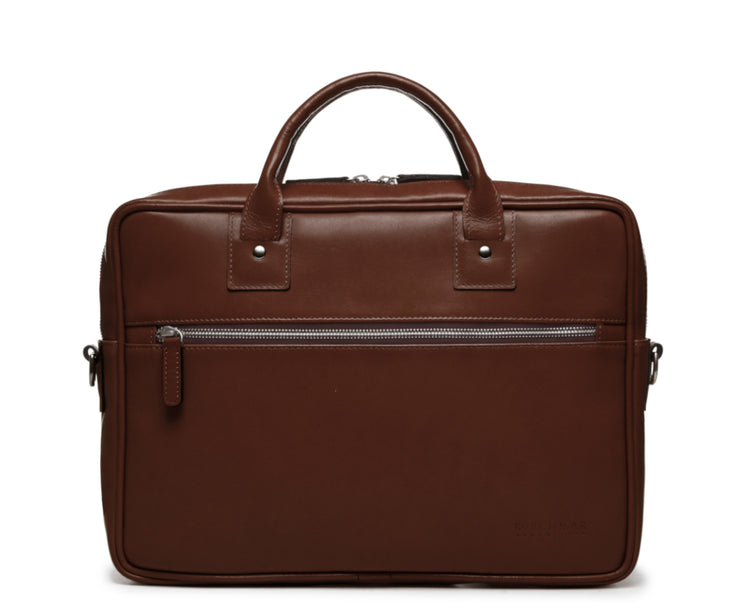 "Brown Slim Leather Briefcase The Edwin leather briefcase features a removable, adjustable shoulder strap and built-in laptop sleeve. It is designed with a secure top zipper, and can safely accommodate most 13"" laptops."