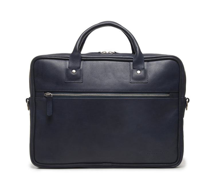 "Ocean Blue Slim Leather Briefcase The Edwin leather briefcase features a removable, adjustable shoulder strap and built-in laptop sleeve. It is designed with a secure top zipper, and can safely accommodate most 13"" laptops."