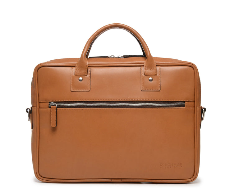 "Tan Slim Leather Briefcase The Edwin leather briefcase features a removable, adjustable shoulder strap and built-in laptop sleeve. It is designed with a secure top zipper, and can safely accommodate most 13"" laptops."