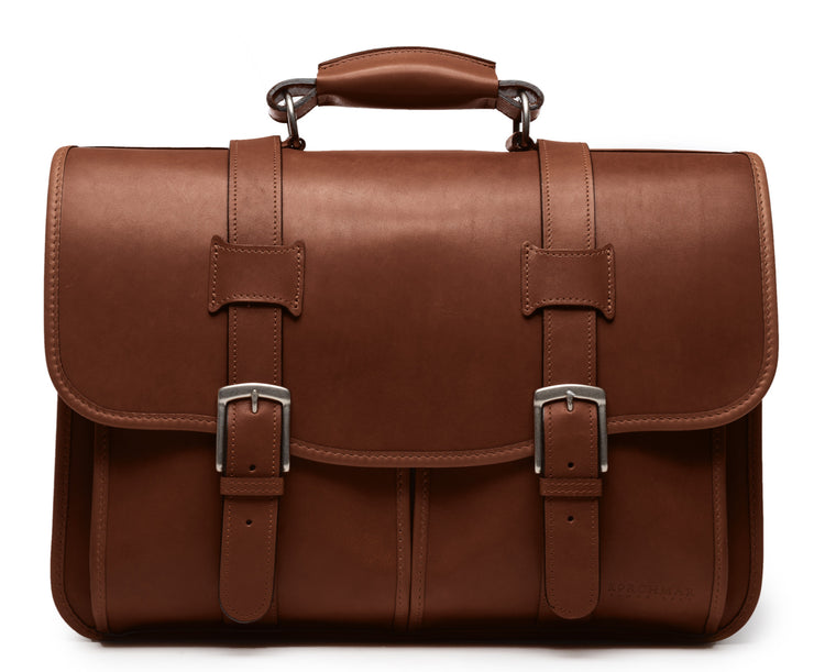 Brown Leather Laptop Briefcase The Garfield business briefcase in Korchmar's Classic Leather is made of American cowhide leather that is selected from the top 5% of available hides. Colored only with aniline dyes, this leather retains its natural beauty over time and features visible markings that are characteristic of only the finest leather.