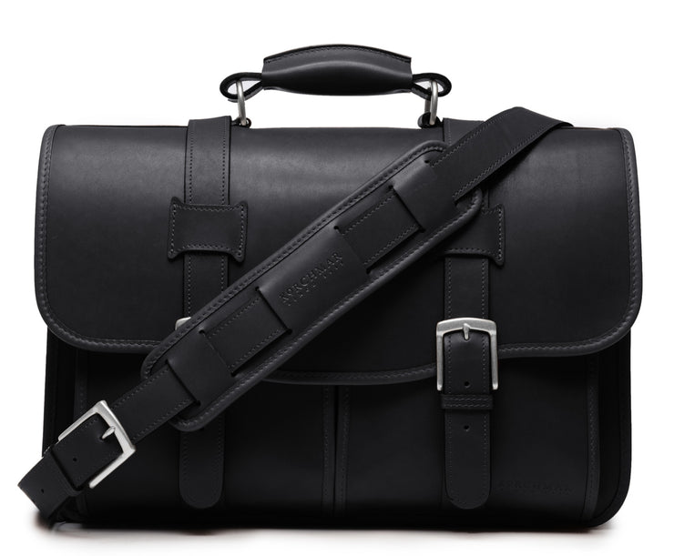 "Black Exterior back pocket and zipped interior pocket Pillow soft padded leather handle Removable, adjustable shoulder strap with ergonomic pad Carry bag strap to slide over telescoping luggage handle Protective laptop compartment Handcrafted with care in our own factory Fits up to a 15"" laptop Dimensions: 16.5"" x 6"" x 13"""
