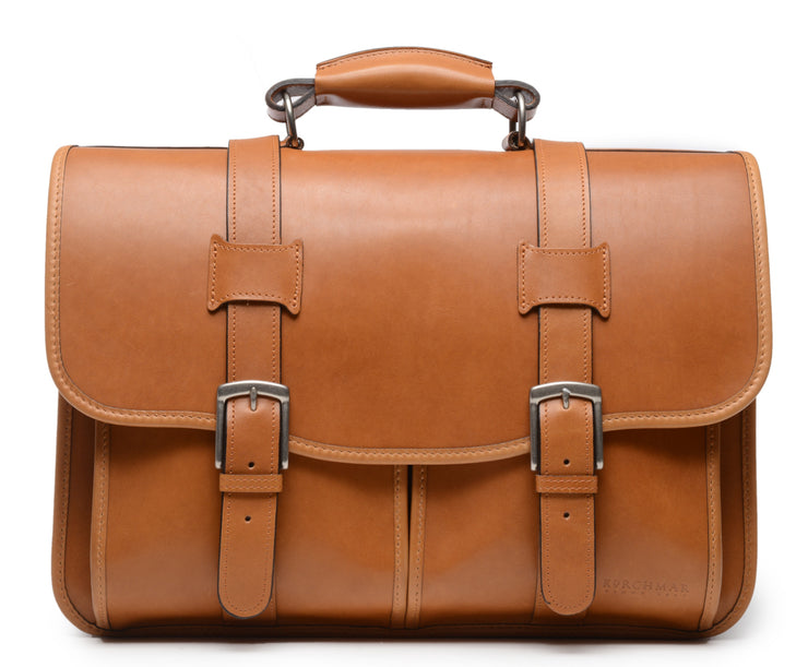 Tan Leather Laptop Briefcase The Garfield business briefcase in Korchmar's Classic Leather is made of American cowhide leather that is selected from the top 5% of available hides. Colored only with aniline dyes, this leather retains its natural beauty over time and features visible markings that are characteristic of only the finest leather.