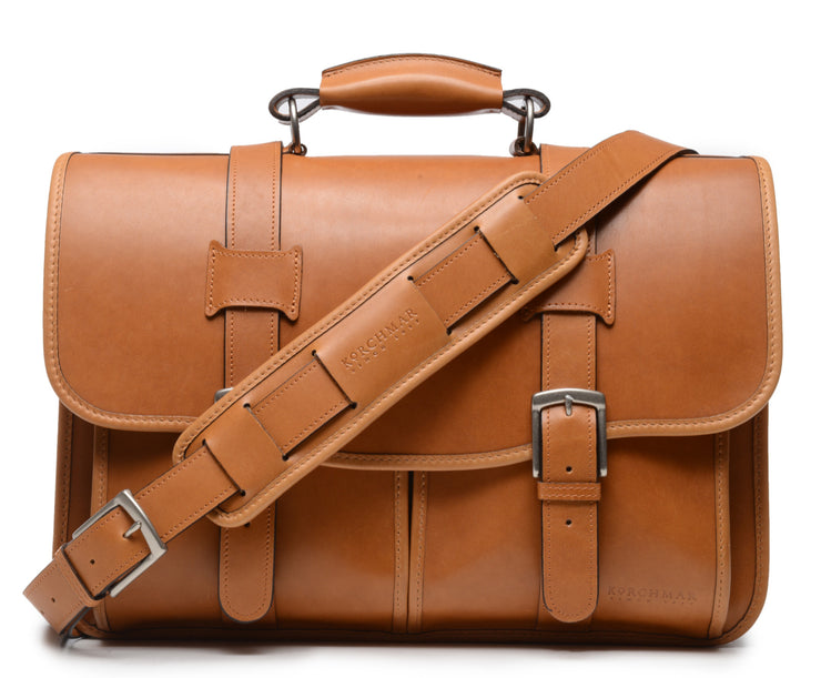 "Tan Exterior back pocket and zipped interior pocket Pillow soft padded leather handle Removable, adjustable shoulder strap with ergonomic pad Carry bag strap to slide over telescoping luggage handle Protective laptop compartment Handcrafted with care in our own factory Fits up to a 15"" laptop Dimensions: 16.5"" x 6"" x 13"""