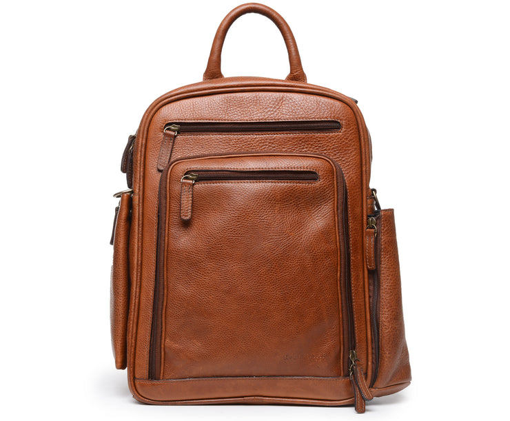 "Brown Leather Commuter Backpack The Graham commuter backpack brings modern features and functionality to a classic design. Handcrafted with American full-grain leather, this meticulously appointed backpack offers extensive organizational capacity in a sleek, compact silhouette. The Graham features nine convenient exterior pockets, two of which offer easy access to a water bottle, sunglasses, or other on-the-go items. The Graham commuter backpack is designed to accommodate most 15"" laptops."