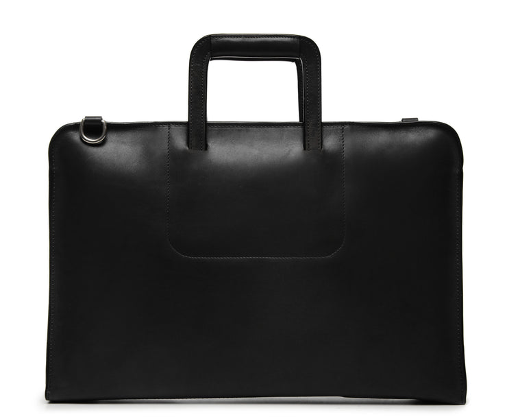 Black Leather Zippered Briefcase The Jackson is handcrafted with a beautiful full grain mill dyed American leather in a timeless Korchmar design. It includes a removable padded laptop sleeve. Historically not an item designed for shoulder carry, the new, improved design includes a full length adjustable shoulder strap.