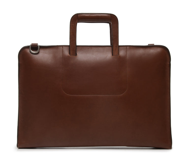 Brown Leather Zippered Briefcase The Jackson is handcrafted with a beautiful full grain mill dyed American leather in a timeless Korchmar design. It includes a removable padded laptop sleeve. Historically not an item designed for shoulder carry, the new, improved design includes a full length adjustable shoulder strap.