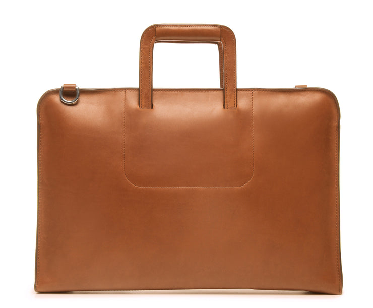Tan Leather Zippered Briefcase The Jackson is handcrafted with a beautiful full grain mill dyed American leather in a timeless Korchmar design. It includes a removable padded laptop sleeve. Historically not an item designed for shoulder carry, the new, improved design includes a full length adjustable shoulder strap.