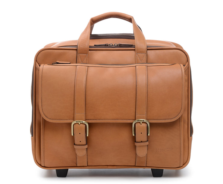 "Tan Wheeled Leather Travel Briefcase The Kenton full grain leather rolling laptop bag also functions as a convenient overnight bag. It features a generous compartment for a change of clothes, as well as plenty of room for files, and padded pocket designed to safely accommodate most 15"" laptops."