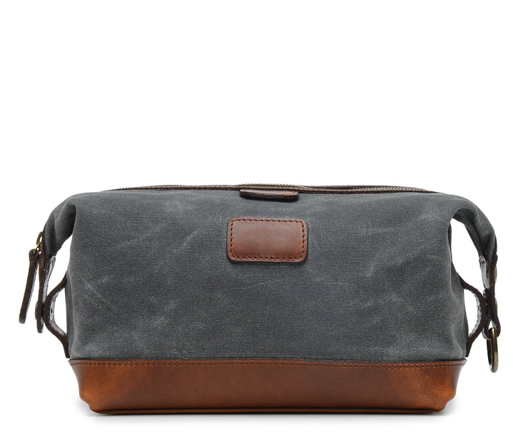 Grey Waxed Canvas Dopp Kit The Ryder is a compact waxed canvas toiletry bag with full grain leather trim. This Dopp Kit features a top zipper and snap down ends that allow for maximum expansion.
