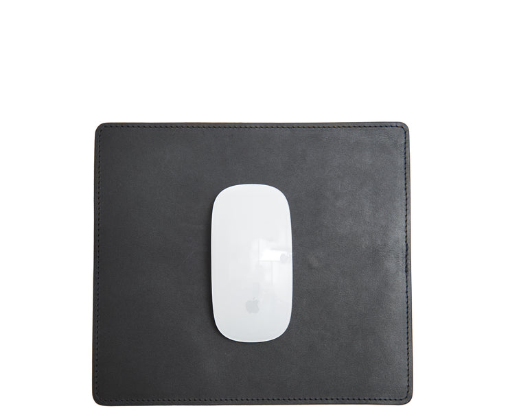 "Black Full-grain American leather Backed with non-skid durable rubber mat Each mouse pad's selection is one-of-a-kind and slightly unique given the natural characteristics of the leather Handcrafted with care in our own factory Dimensions: 9"" H x 8"" W"
