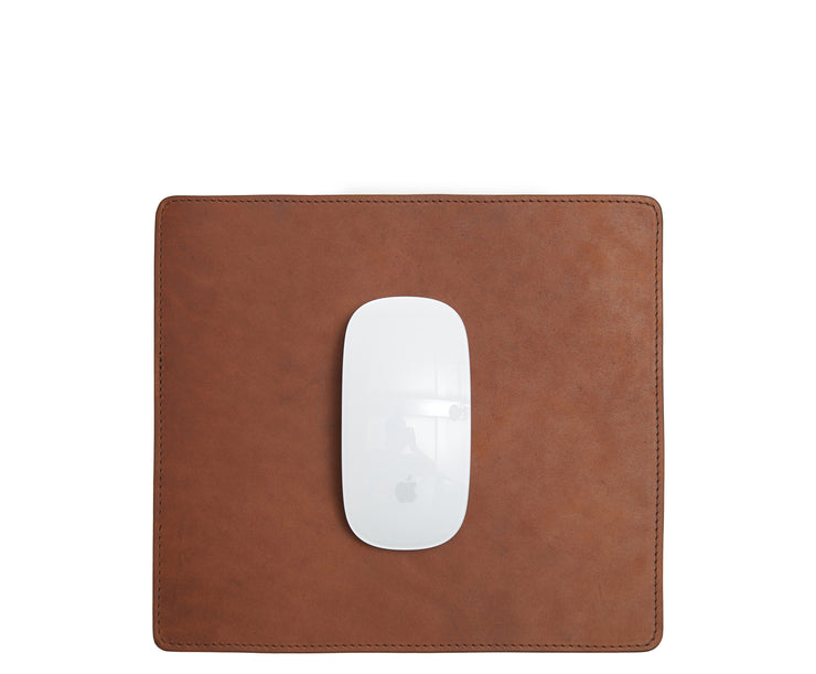 "Espresso Full-grain American leather Backed with non-skid durable rubber mat Each mouse pad's selection is one-of-a-kind and slightly unique given the natural characteristics of the leather Handcrafted with care in our own factory Dimensions: 9"" H x 8"" W"