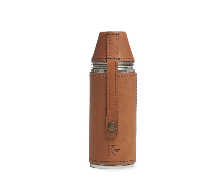 Espresso Leather bottle flask Crafted with sturdy stainless steel and wrapped in American full-grain leather, the Radcliff leather bottle flask oozes style and convenience. The Radcliff leather bottle flask includes 4 stainless steel serving cups as well as a stainless steel flask funnel for easy filling.