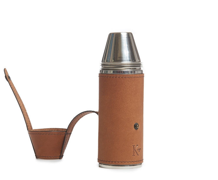 "Espresso Full-grain American leather Includes stainless steel flask funnel and four stainless steel serving cups 8 oz capacity Handcrafted with care in our own factory Dimensions: 6.5"" H x 2"" D"