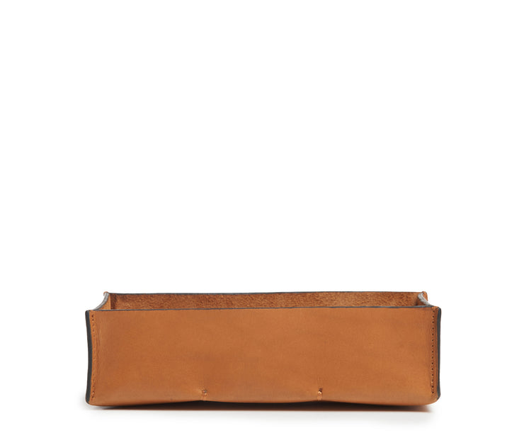 Tan Leather desk tray Keep your pencils, pens and other small office essentials organized and easily at reach with the Litton leather pencil tray. The Litton is handcrafted with top-quality full-grain American leather and uses whip-stitches to help form a secure flat base.