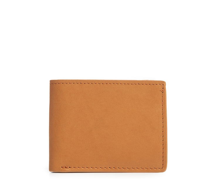 Tan Slim leather wallet The York leather billfold is handcrafted with American full-grain leather and offers a slim minimalist profile. With six scalloped credit card pockets and a vertical stash pocket, the York is perfect for traveling light while keeping your cards and cash secure.
