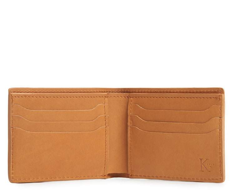 "Tan Hover Slim leather wallet Handcrafted with American full-grain vegetable tanned leather Slim but full featured with 6 credit card pockets One vertical stash pockets Scalloped shape card slots to allow for easy card recognition All edges are hand burnished and inked Fully lined bill compartment for easy entry and exit of bills Dimensions: 3.5"" x .5"" x 4.5"""