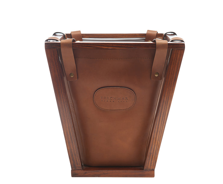 Espresso Leather wastebasket Here's a wastebasket you won't want to hide in the corner or under a desk. The Winslow leather wastebasket features full-grain American leather that is suspended securely on a beautiful pine wood frame. The Winslow leather wastebasket has a 4-gallon capacity and is the perfect size for your home office, bedroom or bathroom