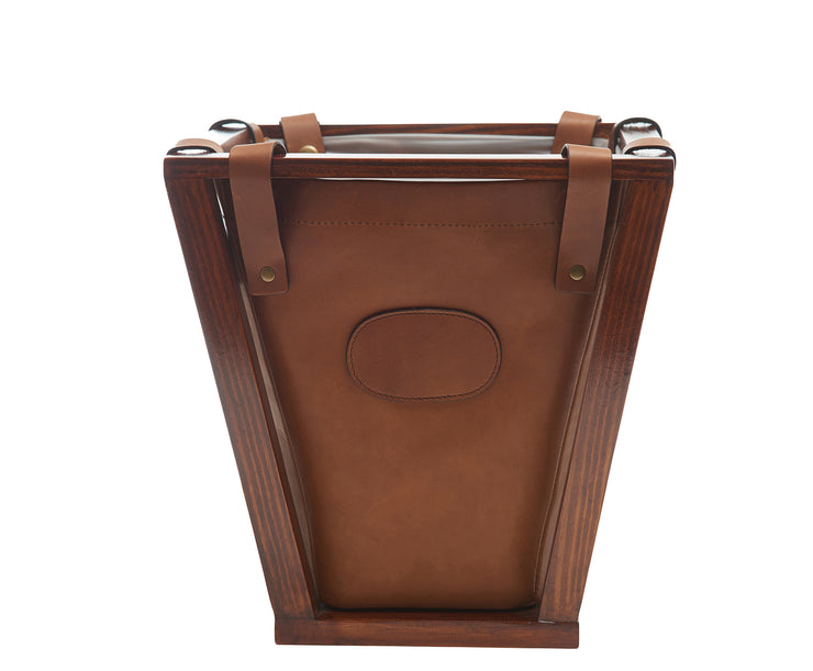 "Espresso Full-grain American leather Strong pine wood frame construction Removable, easy to clean liner 4-gallon capacity Each waste basket's selection is one-of-a-kind and slightly unique given the natural characteristics of the leather Handcrafted with care in our own factory Dimensions: 12"" W x 12.25"" H (base measures 7.5"" W)"